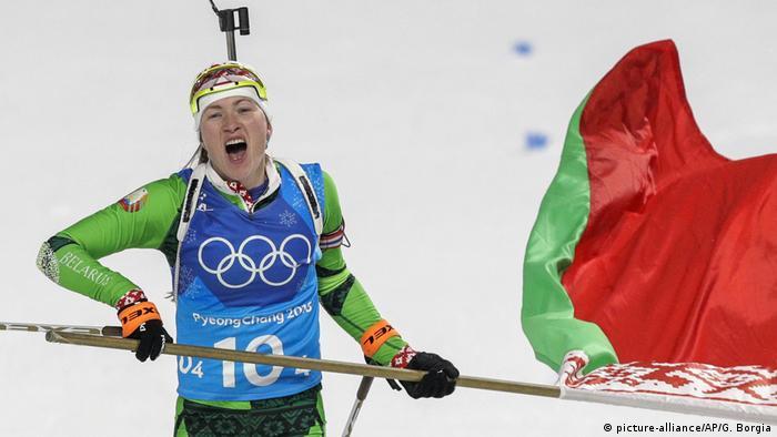 Darya Domracheva, of Belarus, skis across the finish line for the gold medal