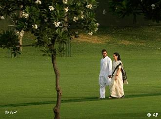 Congress party president Sonia Gandhi, right, strolls with her son Rahul Gandhi as they return after offering tributes to former Indian Prime Minister and Sonia's husband Rajiv Gandhi on his death anniversary, in New Delhi, India, Thursday, May 21, 2009. Gandhi was assassinated by a suspected Tamil Tiger female suicide bomber in 1991 at an election rally in southern India in apparent revenge for sending a peacekeeping force to Sri Lanka in 1987. (AP Photo/Manish Swarup)