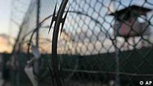 In this photo taken Wednesday, May 13, 2009 and reviewed by the U.S. military, the sun rises over the Guantanamo detention facility at dawn, at the Guantanamo Bay U.S. Naval Base, Cuba. In a speech Thursday, President Barack Obama defended his plans to close the Guantanamo prison camp. (AP Photo/Brennan Linsley)