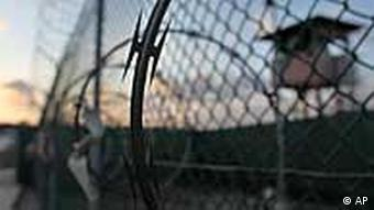 In this photo taken Wednesday, May 13, 2009 and reviewed by the U.S. military, the sun rises over the Guantanamo detention facility at dawn, at the Guantanamo Bay U.S. Naval Base, Cuba. In a speech Thursday, President Barack Obama defended his plans to close the Guantanamo prison camp. (AP Photo/Brennan Linsley
