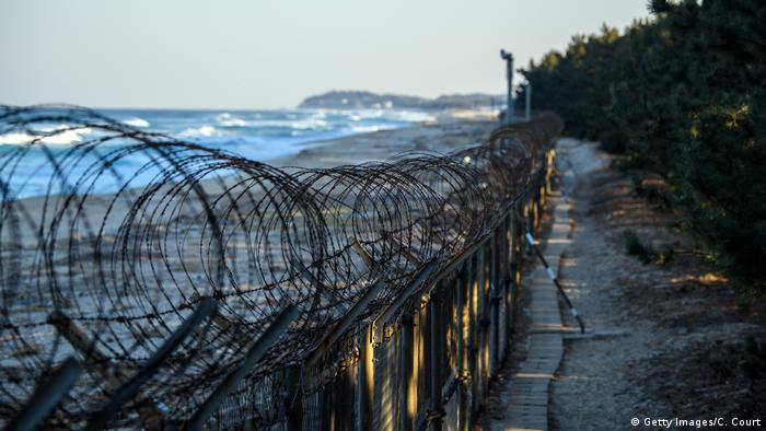 A barbed wire fence runs along a beach near the Korean Demilitarized Zone -- photo from February 3, 2018.