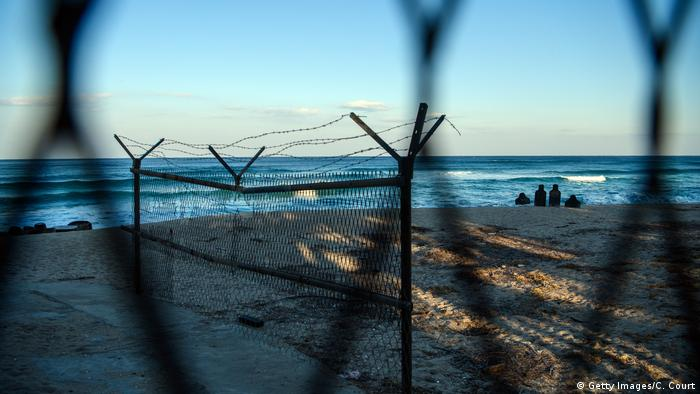 A small shooting range is positioned on a beach behind a barbed wire fence near the Korean Demilitarized Zone