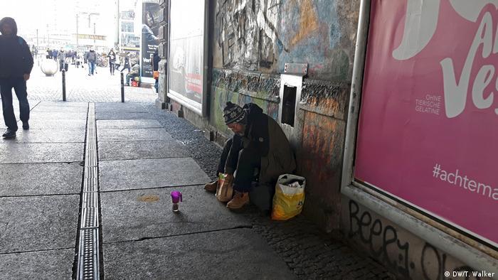 A homeless man under a bridge