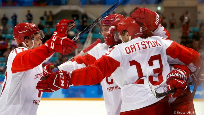 Kirill Kaprizov, Olympic athlete from Russia, reaches for a hug with teammates