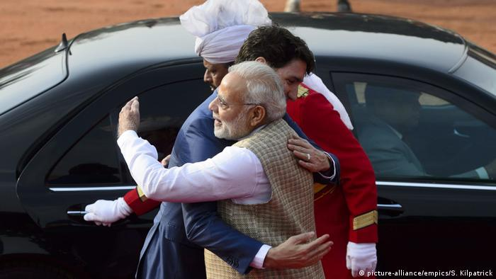 Canadian Prime Minister Justin Trudeau gets a hug from his Indian counterpart Narendra Modi