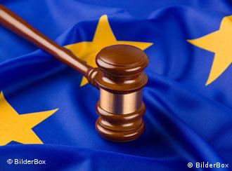A judge's gavel over a European flag
