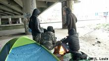 Asylum-seekers, including Ibrahim, next to a tent along Canal St. Martin in Paris
