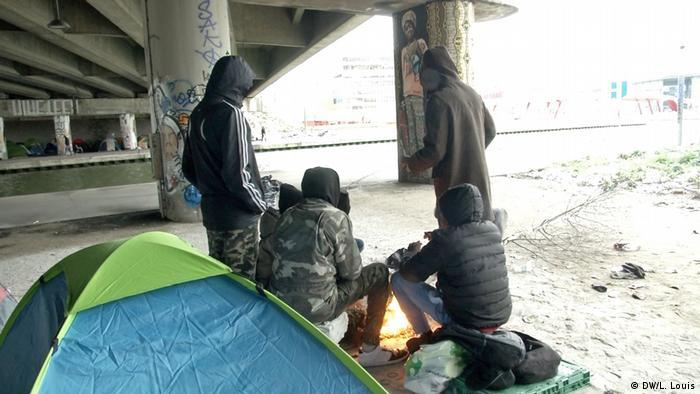 Migrants living under a bridge