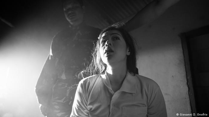 A woman looking scared in a scene from 'Season of the Devil' (Giovanni D. Onofrio)