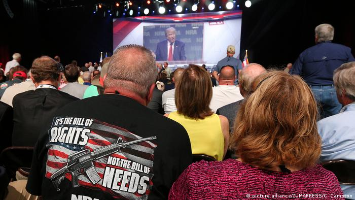 NRA supporters watch Donald Trump