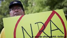 U.S. Army veteran Pax Riddle holds a sign during a rally protesting the National Rifle Association's annual convention a few blocks away in Atlanta, Saturday, April 29, 2017. President Donald Trump spoke at the convention Friday sparking protests from people advocating for stricter gun control measures. (AP Photo/David Goldman) |