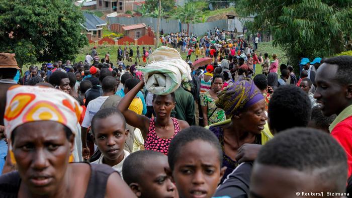 People carry their belongings near Kiziba refugee camp in Rwanda