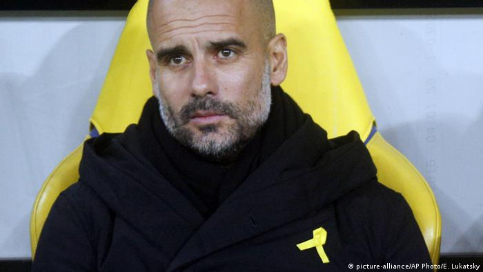 In this Wednesday, Dec. 6, 2017 file photo, Manchester City coach Josep Guardiola looks on during their Champions League group F soccer match against Shakhtar Donetsk at the Metalist Stadium in Kharkiv, Ukraine.