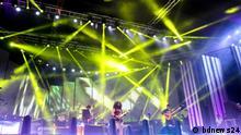 Bangladeshi band musicians playing on stage
