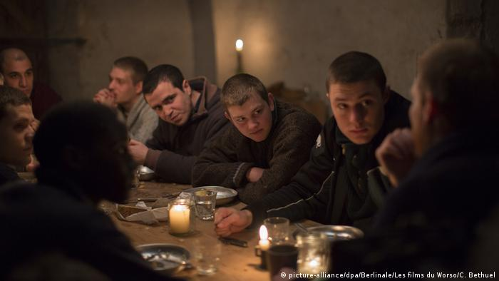 Berlinale film still from 'La prière' shows Anthony Bajon seated at a table with other men (picture-alliance/dpa/Berlinale/Les films du Worso/C. Bethuel)