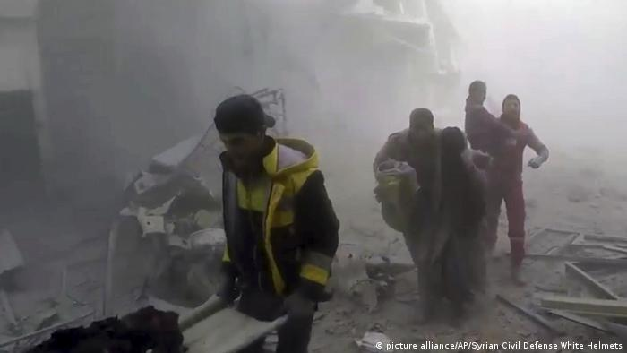 White Helmet rescue teams help residents out of the rubble in eastern Ghouta