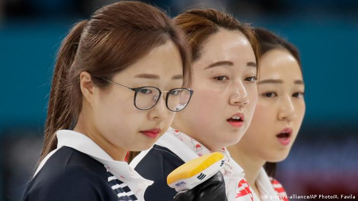 Kim Yeong-mi , of South Korea,, Kim Seonyeong, of South Korea, and Kim Kyeongae, of South Korea, watch during their women's curling final