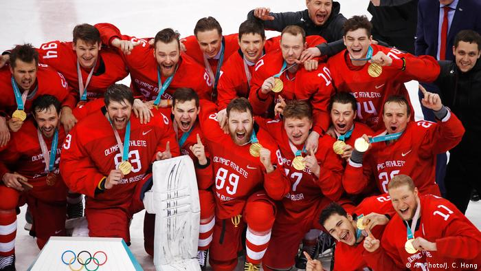 Olympic athletes from Russia celebrate after winning the men's gold medal hockey game against Germany