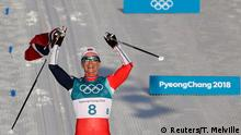 Cross-Country Skiing - Pyeongchang 2018 Winter Olympics - Women's 30km Mass Start Classic - Alpensia Cross-Country Skiing Centre - Pyeongchang, South Korea - February 25, 2018 - Gold medallist Marit Bjoergen of Norway celebrates while holding her national flag. REUTERS/Toby Melville