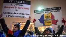 25.02.2018+++ People hold palcards reading Resignation of Dragnea (PSD, rulling party's leader) and Tariceanu (president of the Senate) during a protest against the Justice minister and the corruption in the front of the Romanian Government in Bucharest on February 25, 2018. Romania's justice minister Tudorel Toader launched on Thursday a procedure to sack the popular and internationally respected head of the anti-corruption investigation body. Toader, from the left-wing Social Democratic Party (PSD) said that the head prosecutor of DNA (National Anticorruption Department), Laura Codruta Kovesi had damaged the image of Romania abroad and accused her of being authoritarian. Kovesi has helped bring a raft of corrupt officials to justice in recent years in one of the EU's most graft-ridden countries. / AFP PHOTO / Daniel MIHAILESCU (Photo credit should read DANIEL MIHAILESCU/AFP/Getty Images)