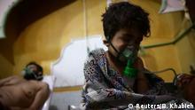 Люди, що постраждали від застосування зарину, у шпиталі Східної Гути