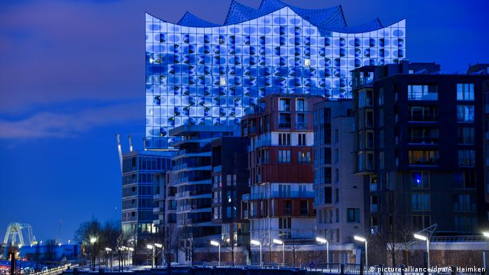 The Elbphilharmonie towers over nearby apartment blocks.