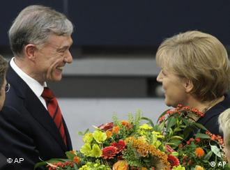 Koehler being congratulated by Chancellor Merkel