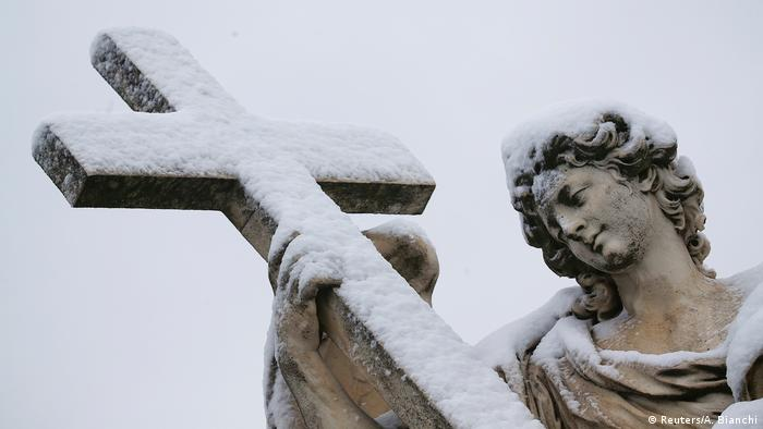A statue is seen covered in snow during a heavy snowfall in Rome.