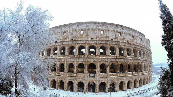 he Colosseum is seen during a heavy snowfall in Rome