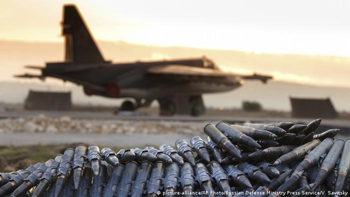 Russian jet in Syria pictured alongside ammunition at the Russian Hemeimeem Air Base