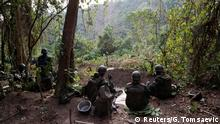 Congolese soldiers from the Armed Forces of the Democratic Republic of Congo (FARDC) rest in an ADF rebel camp, near the town of Kimbau, North Kivu Province, Democratic Republic of Congo, February 19, 2018. REUTERS/Goran Tomasevic SEARCH TOMASEVIC KIMBAU FOR THIS STORY. SEARCH WIDER IMAGE FOR ALL STORIES.