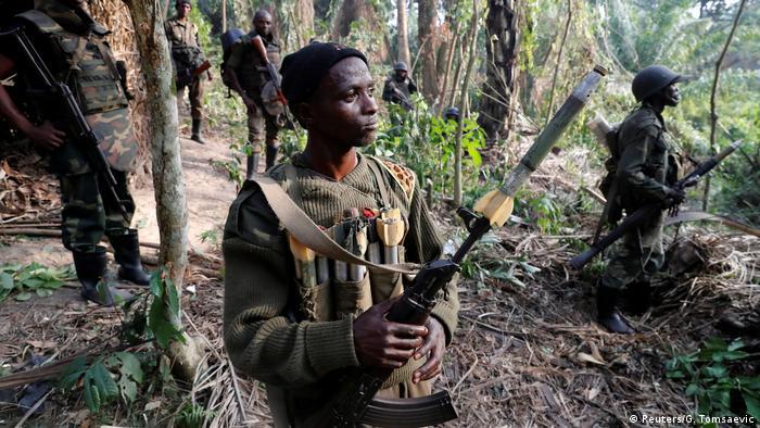 Des soldats des FARDC après avoir pris d'assaut un campement des ADF dans le Nord-Kivu en 2018