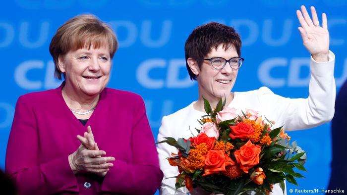 Annegret Kramp-Karrenbauer is congratulated by Angela Merkel (Reuters/H. Hanschke)
