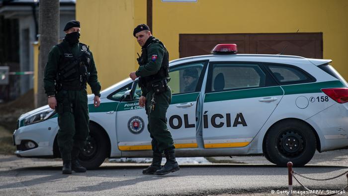 Policemen stand guard at the crime scene where Slovak investigative journalist Jan Kuciak and his girlfriend Marina Kusnirova were murdered