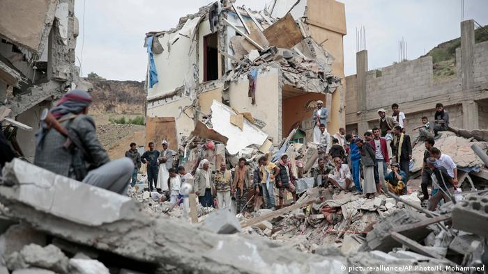 Yemeni's inspect the wholesale destruction of buildings in Sanaa after Saudi-led airstrikes.