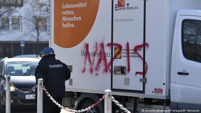 A delivery van with the word 'Nazi' written on it in graffiti
