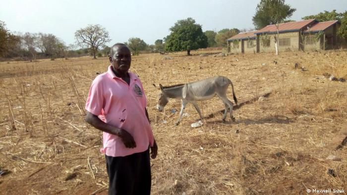Akasoma James with one of his donkeys in Ghana