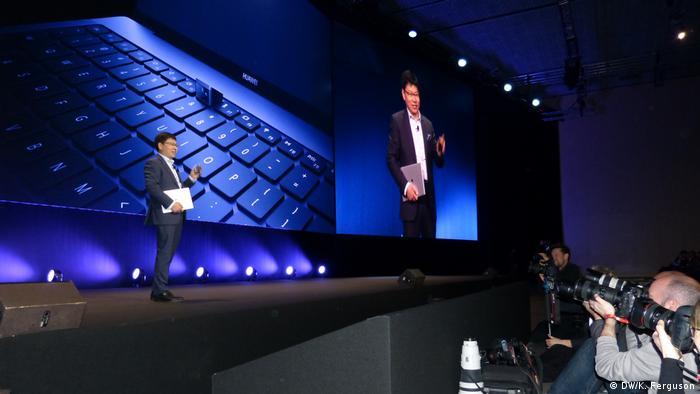Huawei company representative presenting new Huawei keybord camera