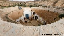 Saliha Mohamedi, 36, sits with her children at their troglodyte house on the outskirts of Matmata, Tunisia, February 4, 2018. I don't want to leave my house, it would be as if I was throwing my life and my traditions away, Saliha said. REUTERS/Zohra Bensemra SEARCH BENSEMRA MATMATA FOR THIS STORY. SEARCH WIDER IMAGE FOR ALL STORIES.