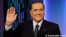 21.02.2018 +++ FILE PHOTO: Italy's former Prime Minister Silvio Berlusconi waves before the taping of the television talk show 8 e mezzo (8 and half) in Rome, Italy February 21, 2018. REUTERS/Max Rossi/File Photo