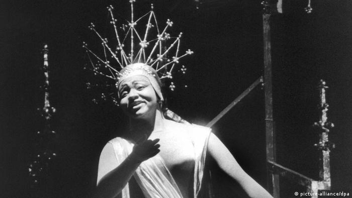 Grace Bumbry wearing an elaborate costume and an outrageously spiked crown