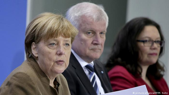 Angela Merkel, Horst Seehofer and Andrea Nahles address the media during a press conference in Berlin, Germany