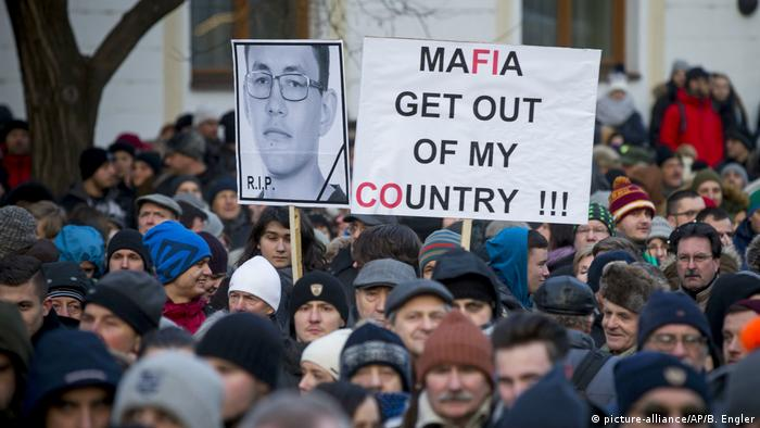 Protesters in Slovakia hold a sign saying, 'Mafia get out of my country!'