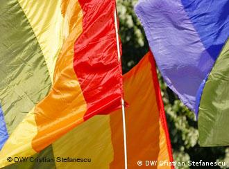 Colourful flags in a gay demostration