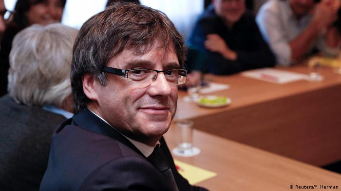 Former Catalan president Carles Puigdemont takes part in a meeting with members of the Catalan Parliament, in Brussels.