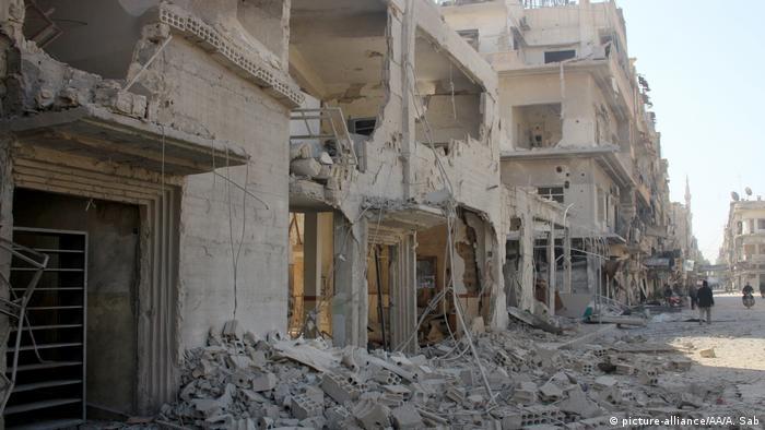 Buildings in ruins after Syrian regime airstrikes