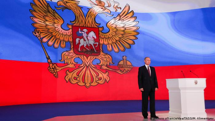 Russlian President Vladimir Putin delivering his annual address (picture-alliance/dpa/TASS/M. Klimentyev)