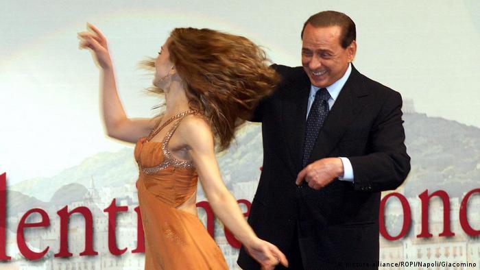 Silvio Berlusconi dances with a woman