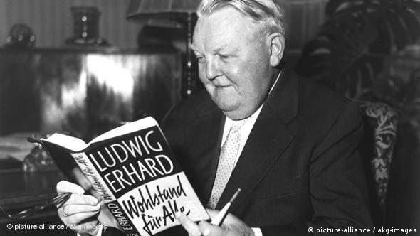 A 1957 photo of Ludwig Erhard reading a book