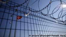 The Turkish flag is seen at the Ipsala border gate with Greece, in Turkey¿s northwestern province of Edirne, Sunday, Jan. 24, 2016. Academicians, NGO representatives and human right activists from Turkey and Greece demonstrated at the crossing to make a call for opening the borders for the asylum seekers. More than 850,000 asylum-seekers traveled to Greek islands in 2015 on their journey to central and northern Europe, in the continent's worst refugee crisis since World War II. (AP Photo/Emrah Gurel)  